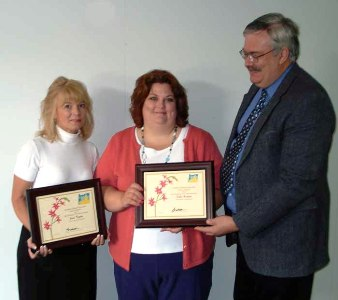 Jann and Debbie receive their award from Jay